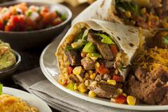 Homemade giant beef burrito Stock Photos