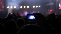 Making video with cell phone at live music concert, festival - stock footage