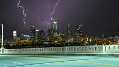 Stock Video Footage of Thunderstorm over Los Angeles Skyline. Empty Road Timelapse