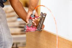 Carpenter use air-gun for make new furniture Stock Photos