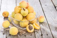 some apricots - stock photo