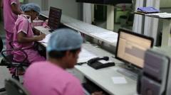 Nurses working on computers - stock footage