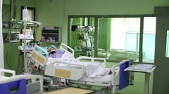 Patient in a hospital on breathing machine - stock footage