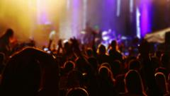 Hands and heads of spectators at a concert Stock Footage