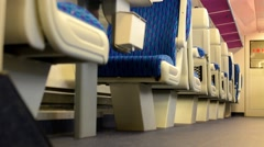 train - interior - seats - first class - door in the background - stock footage