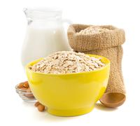 bowl of oat flake on white - stock photo