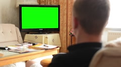 Man watches TV(television) - green screen - living room  - stock footage