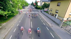 Flying over cyclists in slow motion Stock Footage