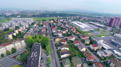 Aerial of bicycle competitors driving through Ljubljana city Stock Footage