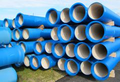 pipes for transporting water and sewerage - stock photo