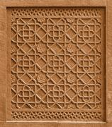 Decorative architectural element with ornament cutting out in stone. india, a Stock Photos