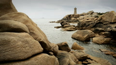 Lighthouse and pink granite rocks, Ploumanach, Cotes d'Armor, Brittany, France - stock footage