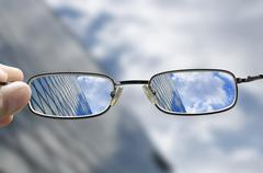 Vision of a glass business building through glasses Stock Photos