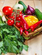 close up of various colorful raw vegetables in a basket - stock photo