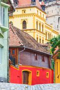 medieval street view in sighisoara founded by saxon colonists in xiii century - stock photo