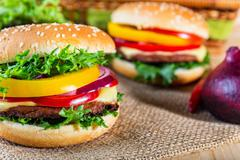 Homemade hamburger with fresh vegetables, close up Stock Photos