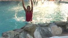 Girl exercising in beautifull pool Stock Footage