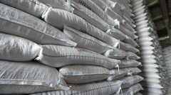 Bags of rice seeds stored in the warehouse in pan low angle shot Stock Footage