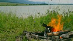 Fire in the background of the lake. Primordial nature Stock Footage