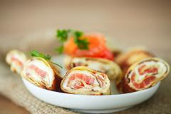 pancakes with cheese curds and salted salmon - stock photo