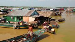 Floating village of Vietnamese refugees on Tonle Sap lake in Siem Reap, Cambodia - stock footage