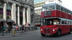Traditional red Routemaster London bus at Monument road junction Stock Footage