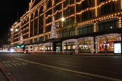 Brompton road in front of Harrods department store during night in London Stock Photos