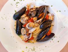Fresh seafood pasta with shellfish and tomato sauce Stock Photos