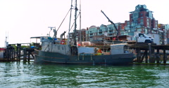 4K Fishing Trawler Boat Unloading at Dockside Whart Stock Footage