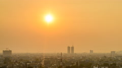 Stock Video Footage of A Hazy Sunset Above Jakarta Skyline, Close View