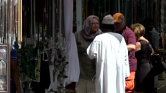 Salalah Arabia Orient Oman sultanate 052 - Omani seller in a white robe - stock footage