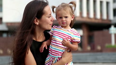 Portrait of a young mother with a child.Young mother on a walk in the city. Stock Footage