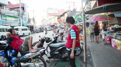 PATTAYA, THAILAND - AUGUST 9, 2014: motorbike taxi drivers - stock footage