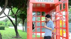 Men were talking telephone in a public phone. HD Stock Footage