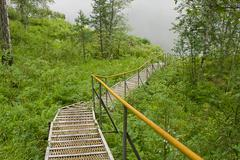 Metallic stair, lowering to the river Stock Photos