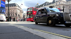 Great shot of Picadilly Circus London with Red Busses Stock Footage