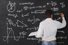 Teacher at the blackboard Stock Photos