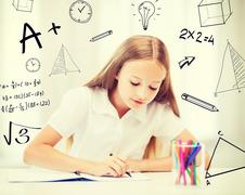 little student girl drawing at school - stock illustration