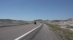 Stock Video Footage of Motocycles on a Desert Highway Riding to Sturgis Rally