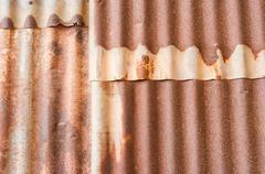 Rusty corrugated metal wall texture background. Stock Photos