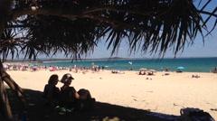 People enjoying the beach in Noosa, Australia Stock Footage