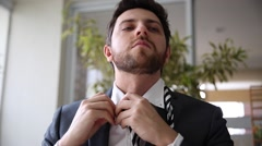 Exhausted Business Man taking off the tie at home Stock Footage