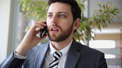 Business Man solving problem on cell phone at home Stock Footage