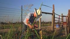 COWBOY RANCHER irrigation ditch valve Stock Footage