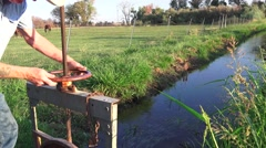 COWBOY RANCHER, horse rancher irrigating Stock Footage
