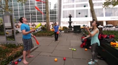 The Bryant Park Jugglers enjoy Juggling with one another in Bryant Park Stock Footage