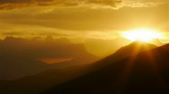 Mystic sunset with sunbeams on top of the hill - stock footage