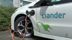 A Liander electric car plugged into a charging point, Arnhem, Netherlands. Stock Footage