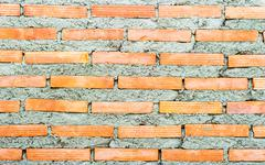 weathered stained brick wall background. - stock photo
