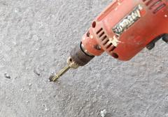 Old drill with concrete Stock Photos